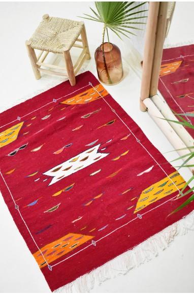 Kilim carpet Papillottes red background