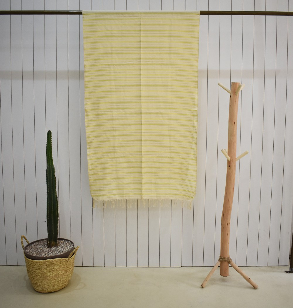Beige and yellow mattress-style throw