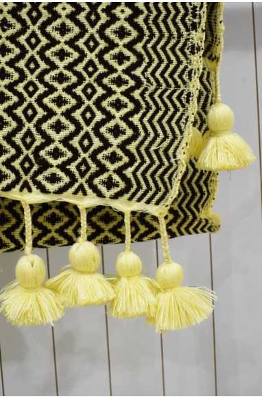 Brown and beige throw with beige tassel finish