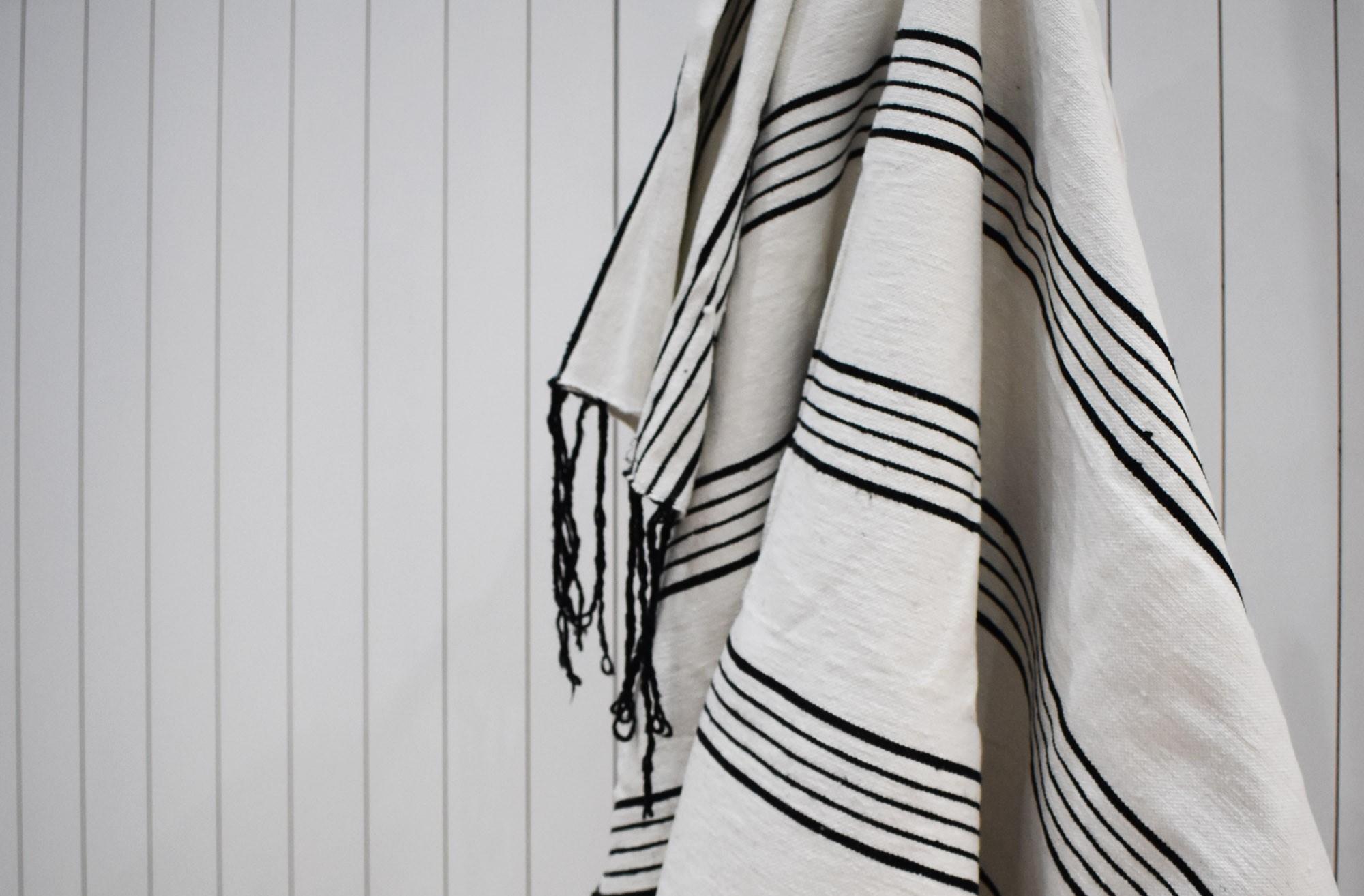 White plaid finely striped black, white pompom finish