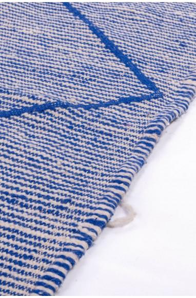 Kilim rug shaded blue, beige and white background