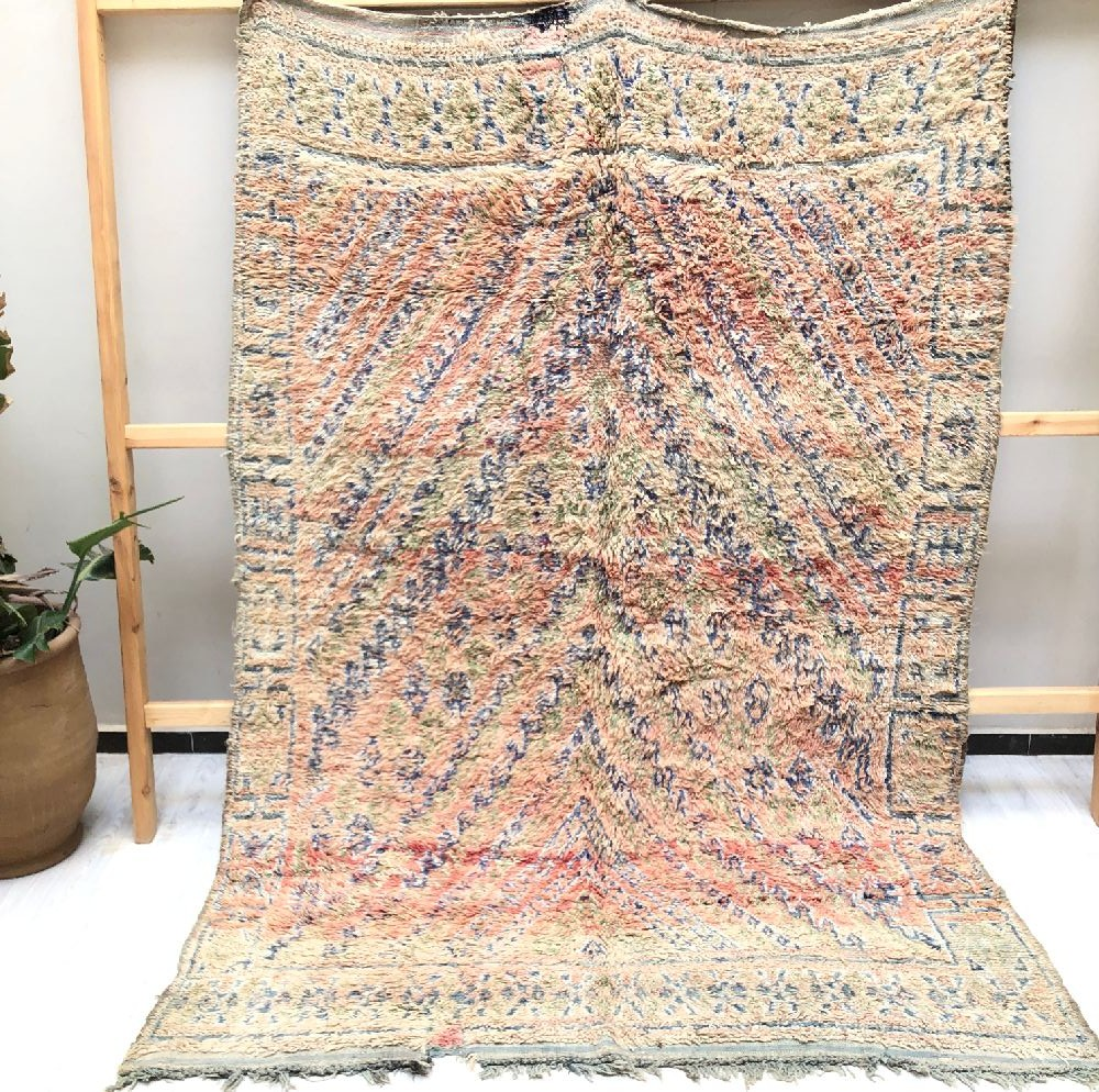 Vintage frayed wool rug