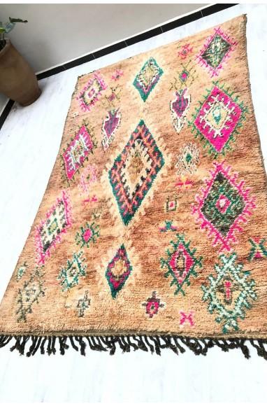 Vintage carpet beige and pink shades background