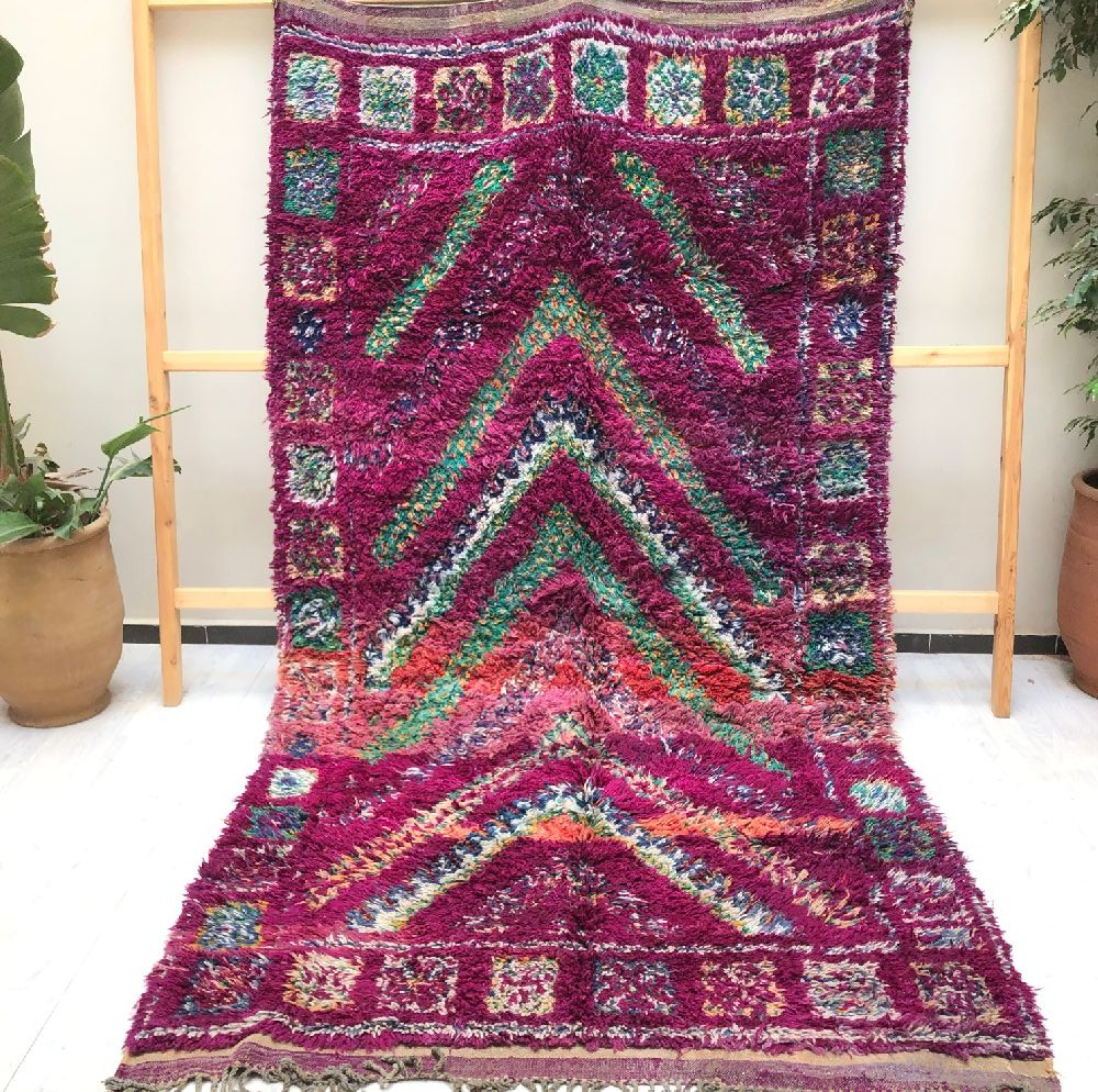 Vintage purple rug in shades of gray, blue and pink