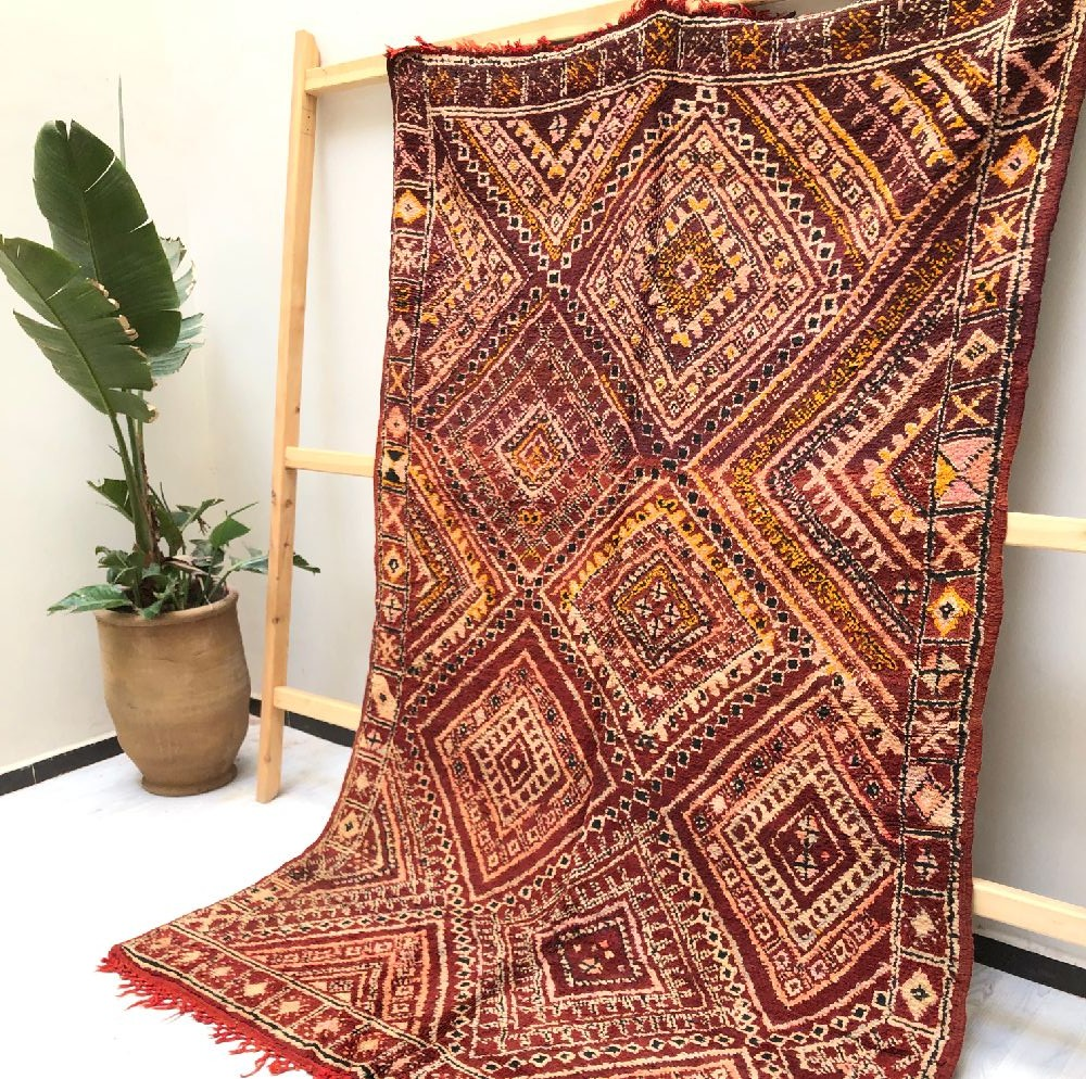 Vintage rug in shades of red, pink and beige