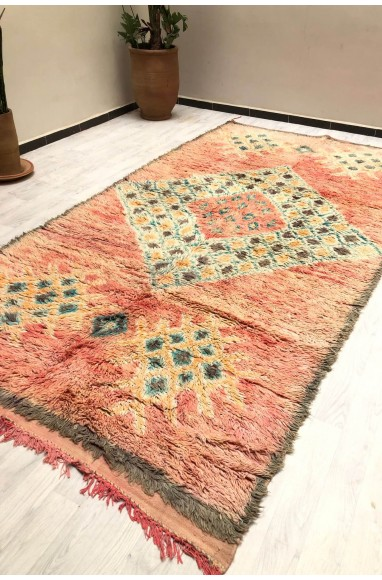 Vintage frayed wool rug and central diamond checkerboard pattern