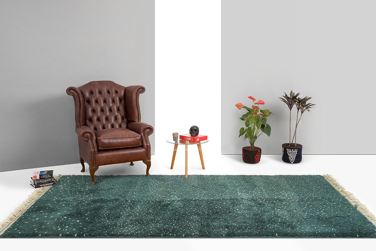Green berber carpet with white dots
