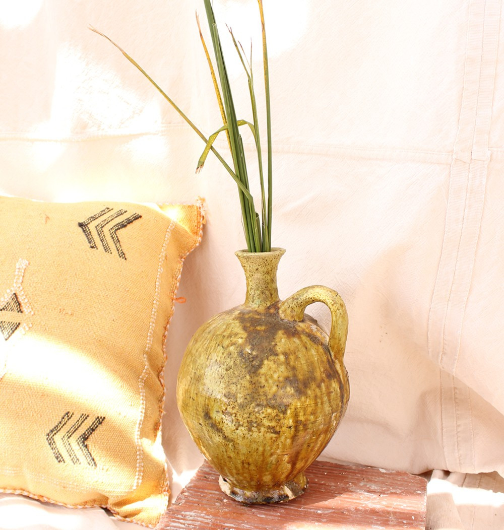 green and ocher water jug