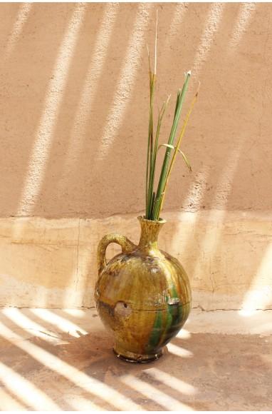 green and ocher water jug