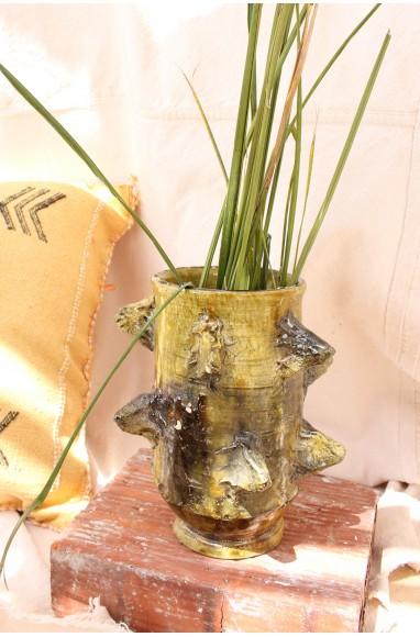 irregular vase with beaks in brown