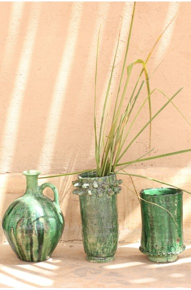 Green glazed vase with pimples