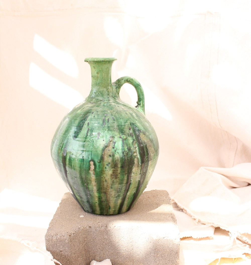 Water jug ​​in shades of green