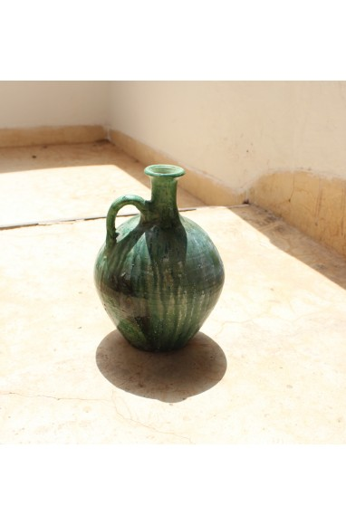 Water jug in shades of green