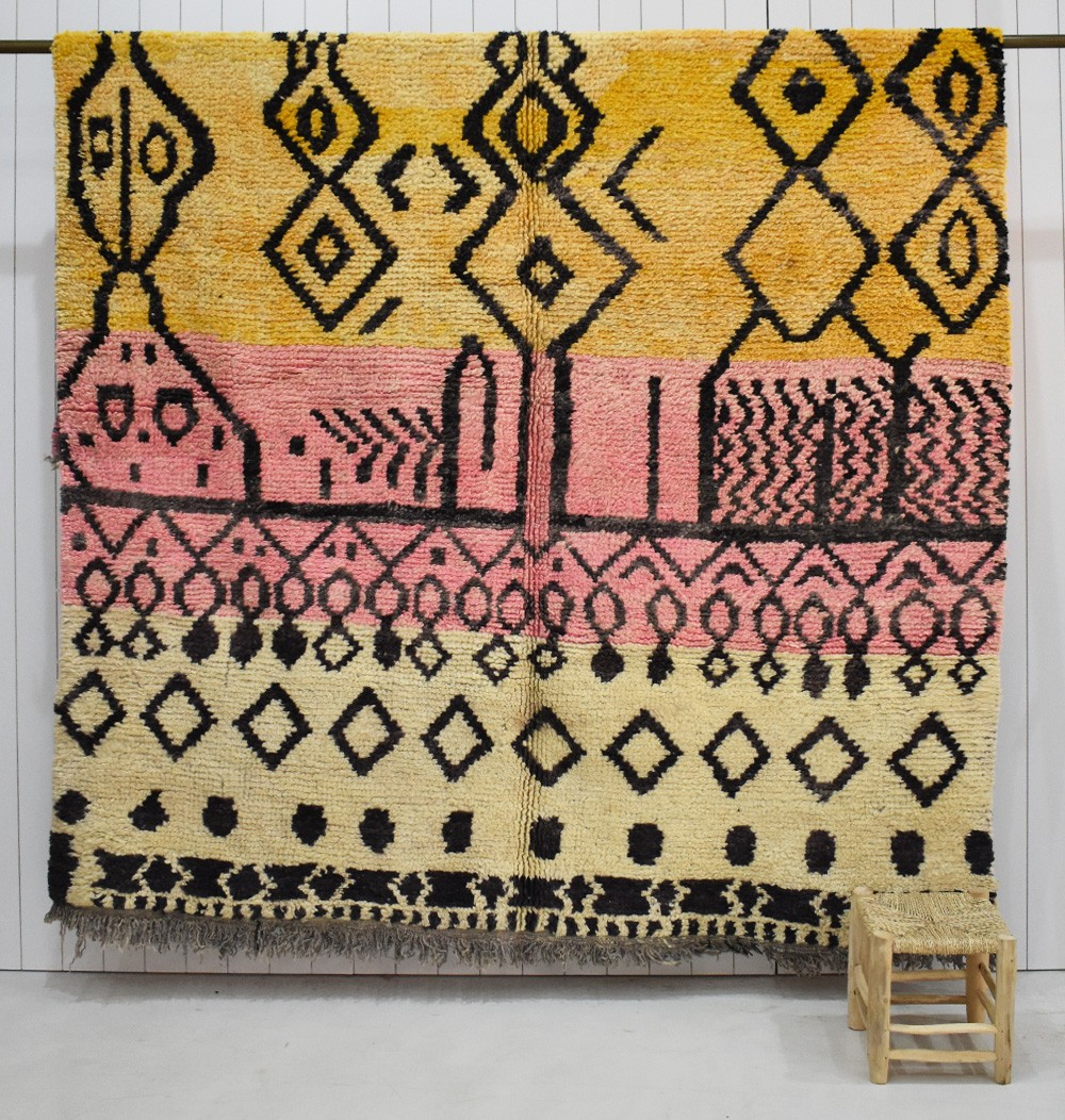 Large beige pink and yellow tricolor rug