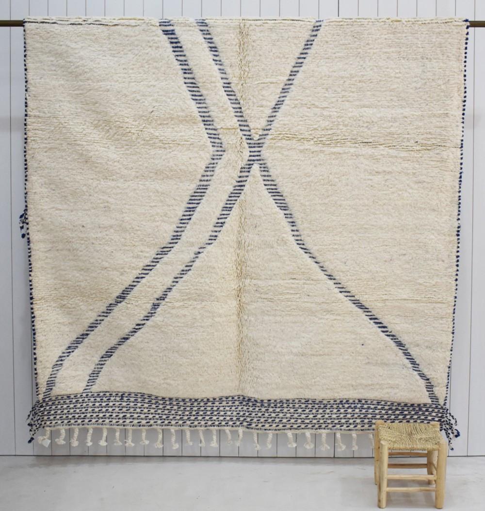 Ecru and blue carpet with X pattern