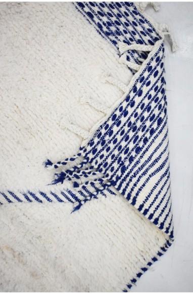 Tapis écru et bleu motif en X