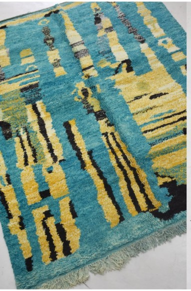 Berber carpet with blue gray background and yellow, green and black patterns