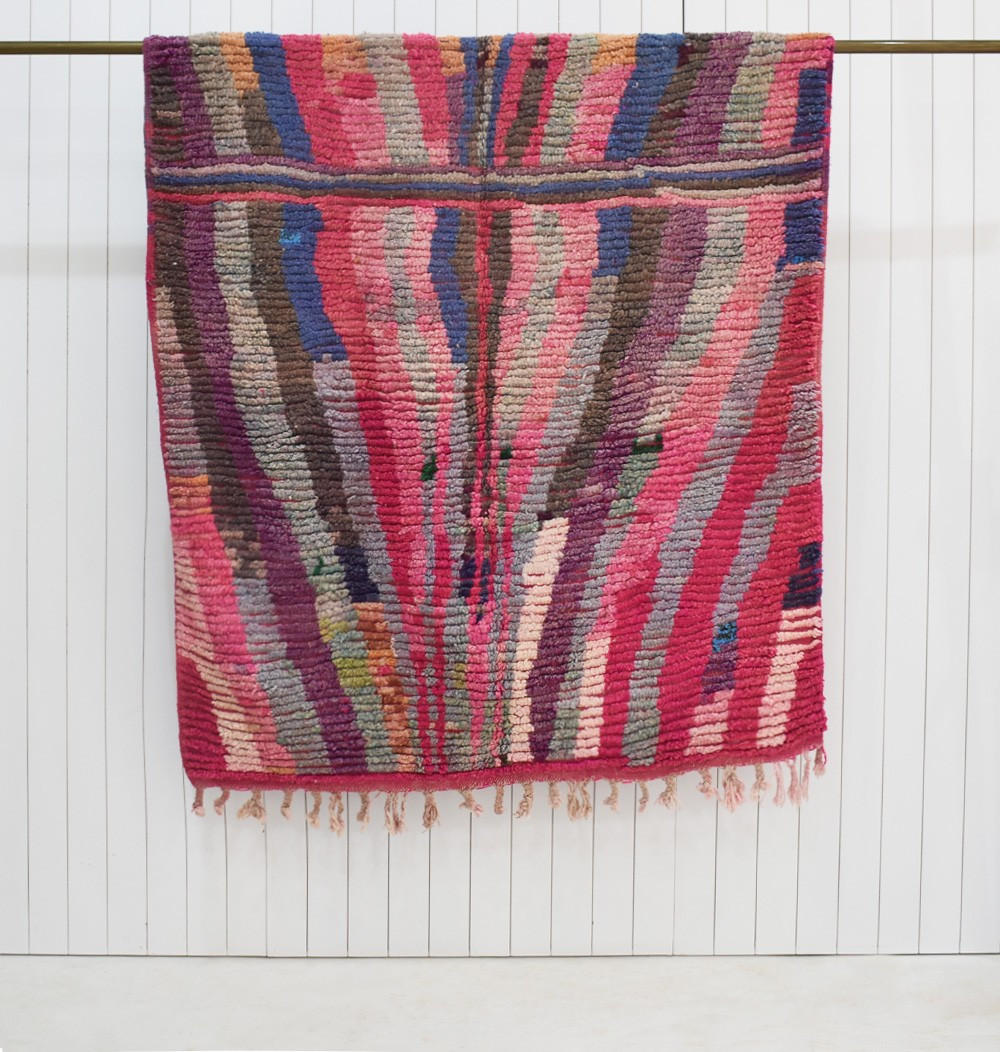 Berber carpet dominant in pink and purple mirror effect