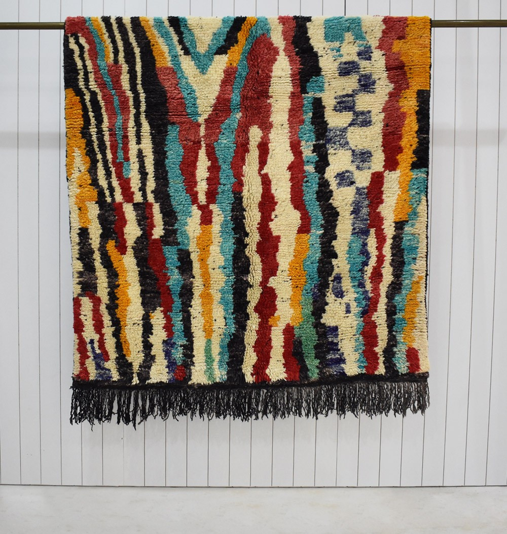 Multicolored Berber carpet with black fringes