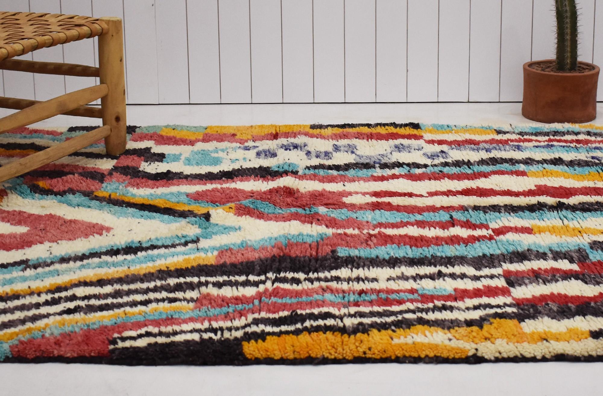 Multicolored Berber carpet with black fringes