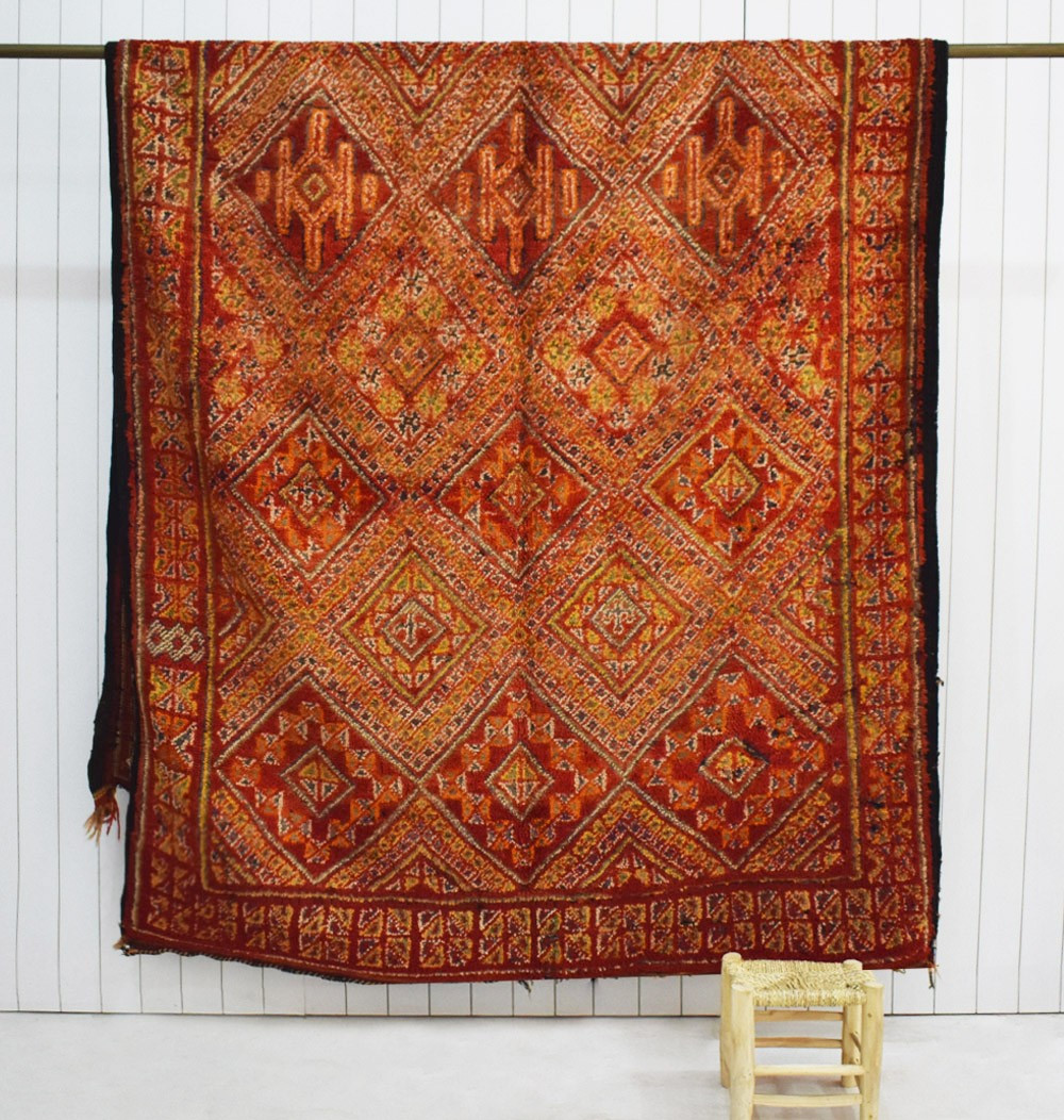 Vintage purple and beige carpet with orange touches