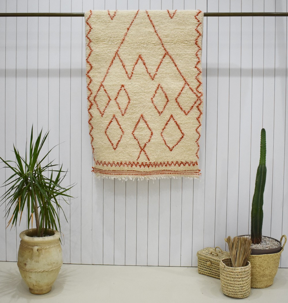 Small orange berber rug in wool