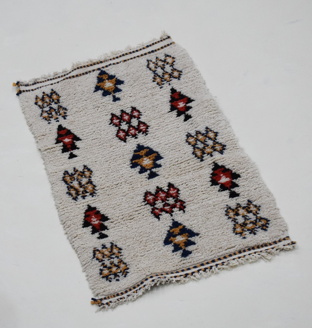 Small Berber rug with abstract Berber patterns