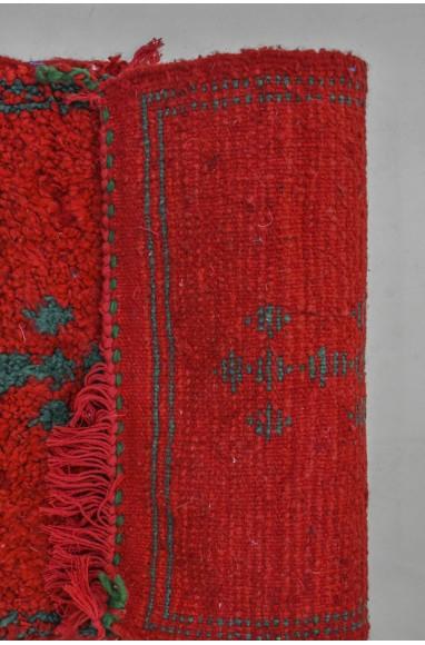 Small red berber carpet