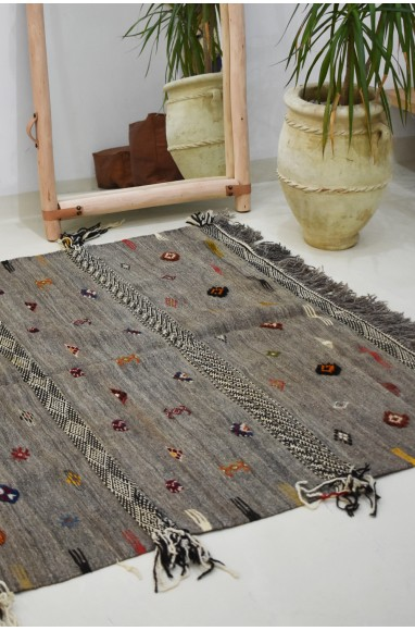 Berber kilm carpet with small colorful patterns