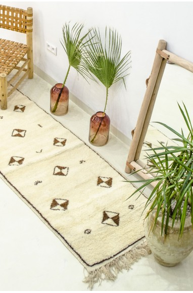 Berber carpet in hallway with symmetrical patterns