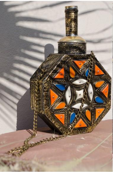 Small blue ornate ceramic satchel