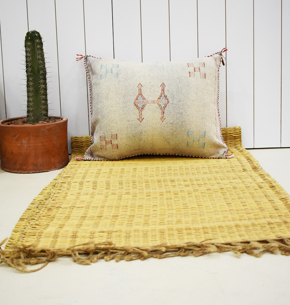 Faded white berber cushion cover