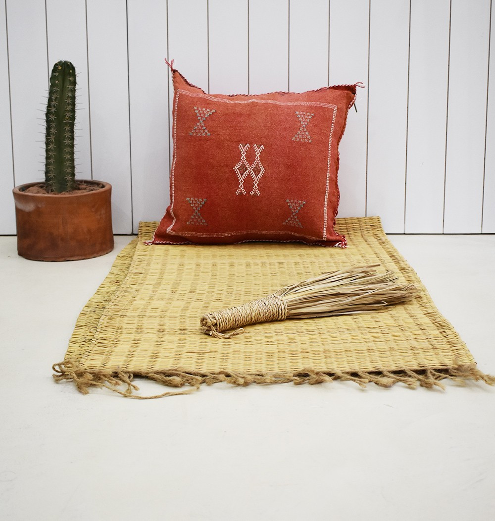 Faded red berber cushion cover
