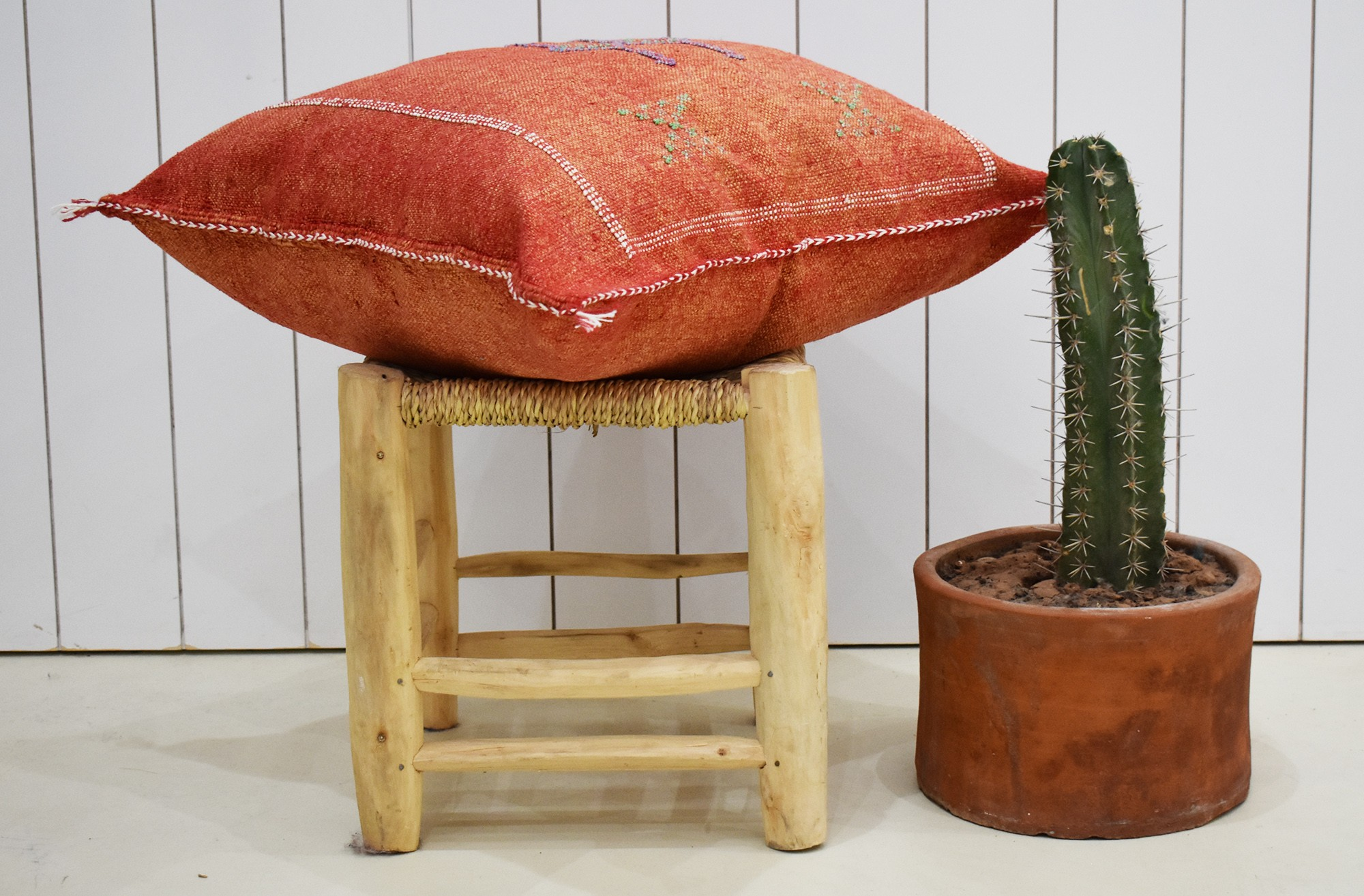 Red Berber cushion cover with orange tones