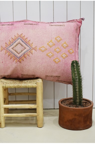 Pink sabra bolster with yellow patterns