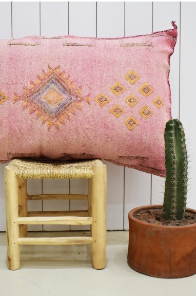 Pink sabra bolster with small yellow patterns