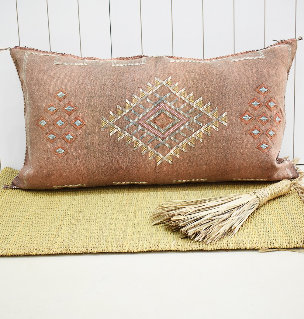 Sabra bolster faded earth small patterns