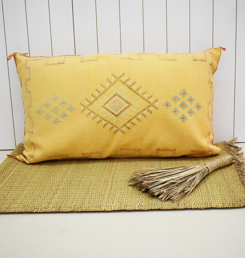 Yellow sabra bolster with blue patterns
